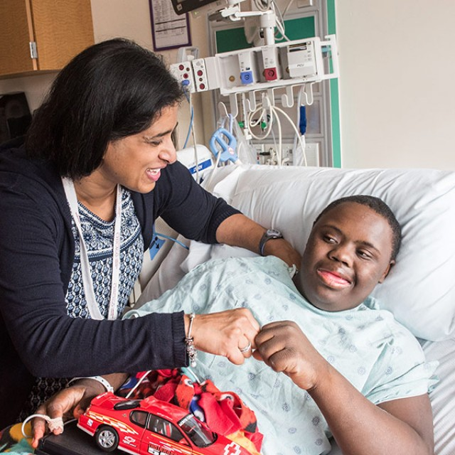 Neethi Pinto, MD, MS, with patient Kyjuan Hudson