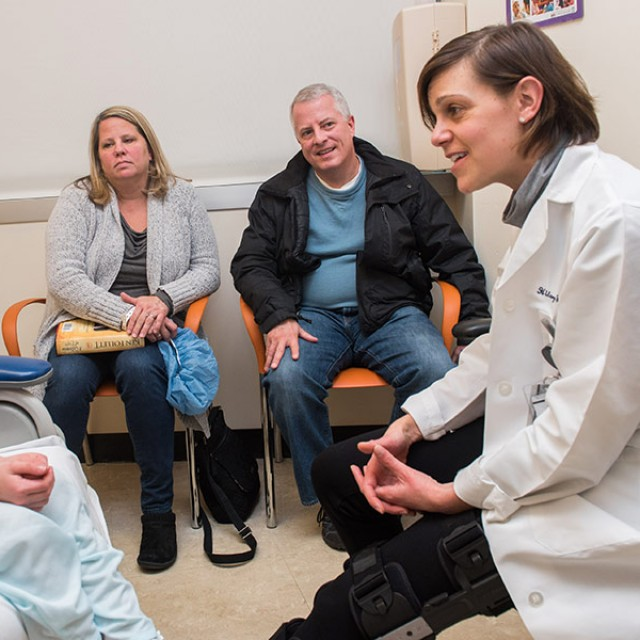 Patient Maeve O'Grady and her parents meet with Hilary Jericho, MD